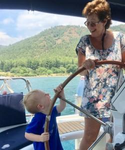 Third generation driving Commodore grandma's boat